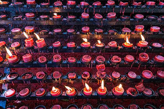 James BO Insogna - Burning Candles of Santa Nino Basilica
