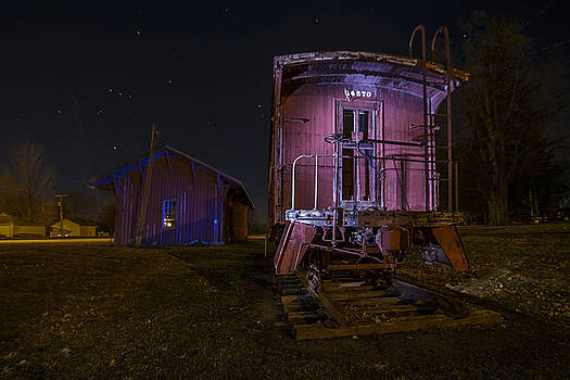 Caboose and depot in rural Illinois one starry night by Sven Brogren