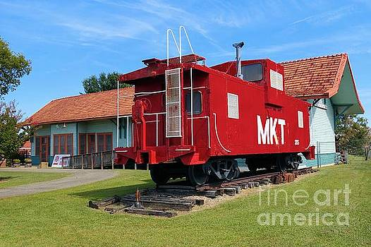 Caboose at Katy Depot in Checotah Oklahoma by Janette Boyd