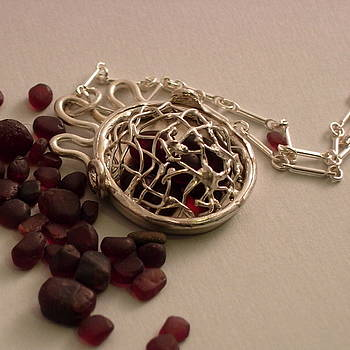 Caged Garnets by Lynette Fast