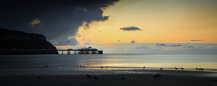 Calm Before the Storm - Llandudno Pier Sunset Panorama by Christine Smart