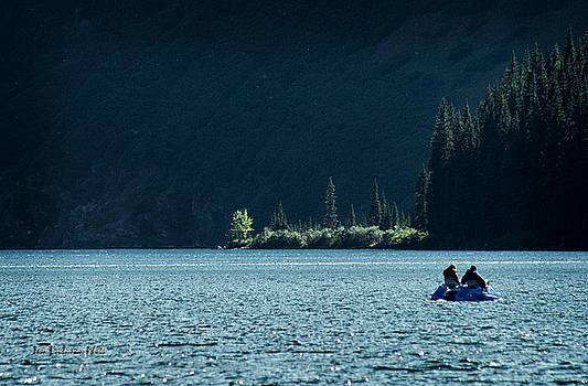 Calm on Cameron Lake by Tom Buchanan