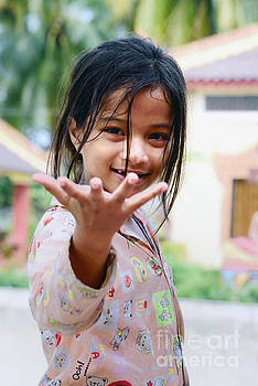 Cambodian girl asking something by Mirko Dabic