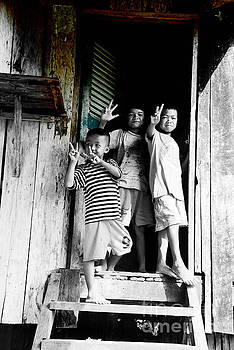 Cambodian kids at the entrance to the barrack by Mirko Dabic