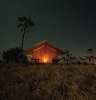 Camp lit by lantern by Justin Carrasquillo