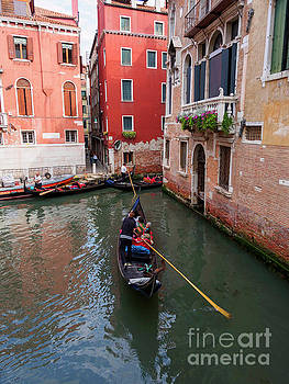Canal junction and gondolas in Venice Italy by Louise Heusinkveld