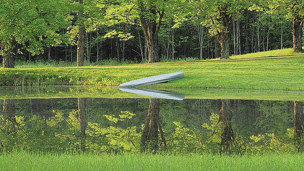 Canoe at ponds edge by Brian Pflanz
