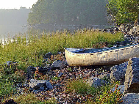 Canoe on the rocks by Brian Pflanz