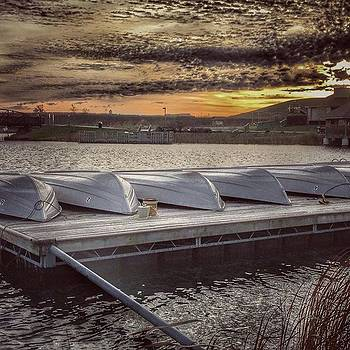 Canoes At Voice Of America Park by Phunny Phace