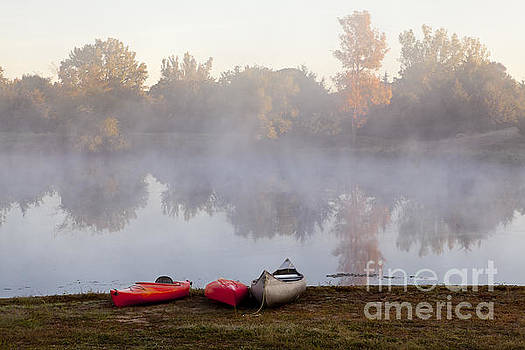 Canoes by a Foggy Lake in Autumn by Sharon Foelz