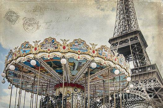 carousel near Eiffel Tower in Paris by Heather Swan