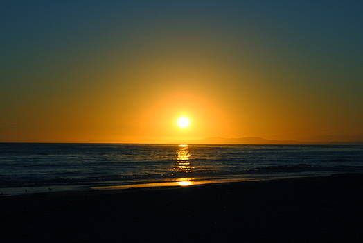 Carpinteria State Beach at Sunset by Bransen Devey
