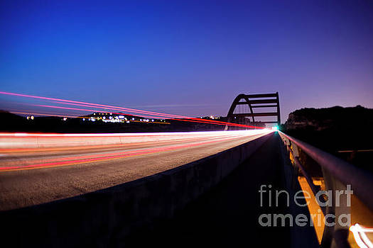 Herronstock Prints - Cars and trucks jettison through the 360 Bridge as if it were a