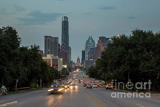 Herronstock Prints - Cars drive past the Congress Avenue Bridge the gateway to the hip and eclectic South Congress Avenue with Texas Capitol and Skyline backdrop