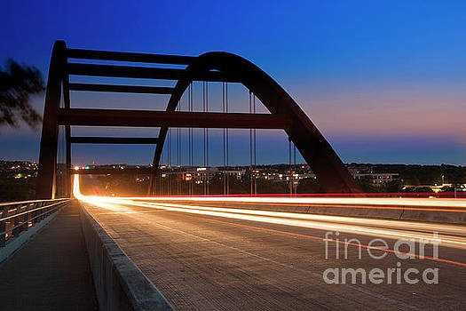 Herronstock Prints - Cars leave light trails as the speed through the Loop 360 Pennyb