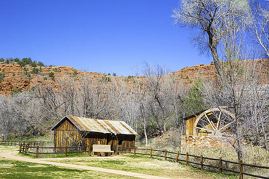 Catherdal rock and Old run down shack and water wheel in Sedona Arizona by Jodi Jacobson