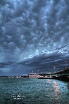 Causeway clouds by John Loreaux