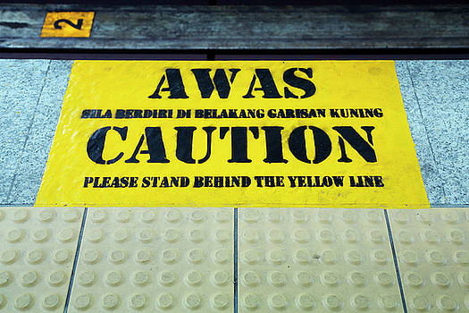Caution sign in malay, Kuala Lumpu by Virginie Blanquart