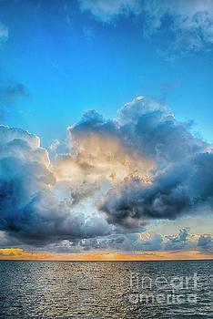 Caye Caulker Vertical Clouds Sunrise by David Zanzinger