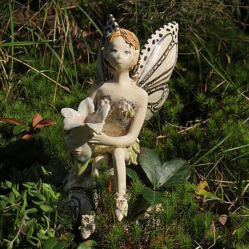 Ceramic fairy in moss by Theresa LaBrecque