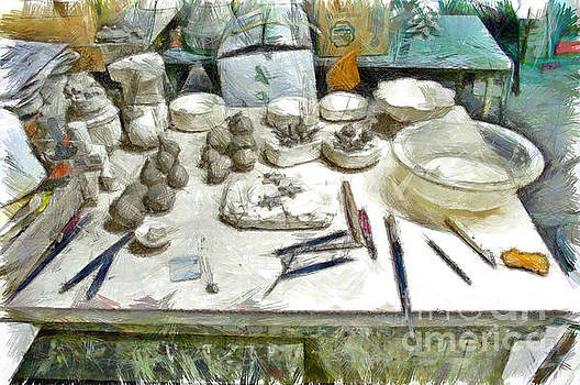 Ceramic objects and brushes on the table by Giuseppe Cocco