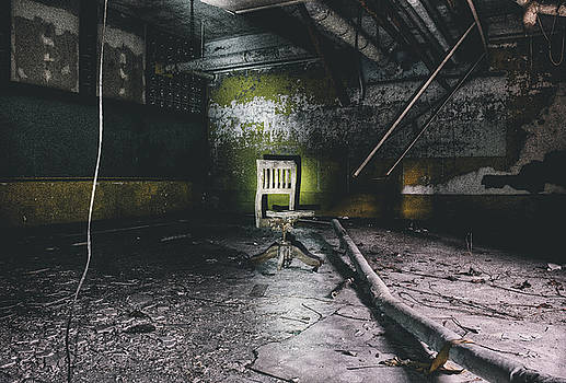 Chair in creepy abandoned basement by Dylan Murphy