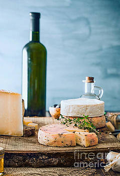 Cheese on wood by Mythja Photography