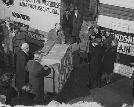 Chicago and North Western Historical Society - Chicago and North Western Execs Load Donation on to Friendship Train - 1947