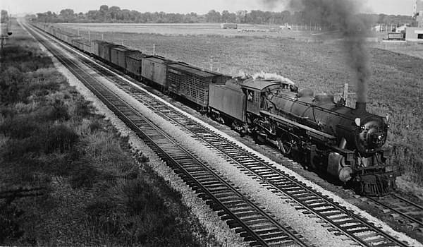 Chicago and North Western Historical Society - Railway Engine Hauls Freight in Iowa - 1931