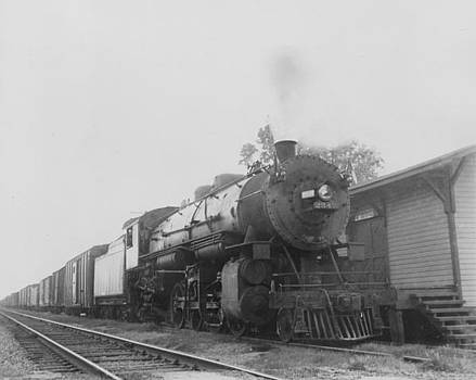 Chicago and North Western Historical Society -  Railway Engine Tows Freight in North Carolina - 1943