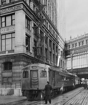 Chicago and North Western Historical Society - Chicago and North Western Train Alongside Wrigley Building