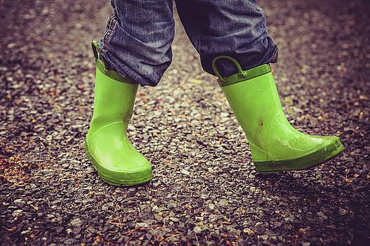Child In Green Mud Rain Boots by Debi Bishop