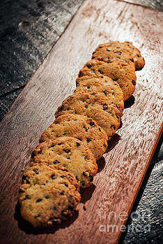 Chocolate Chip Cookie Biscuits On Wooden Board by Jacek Malipan