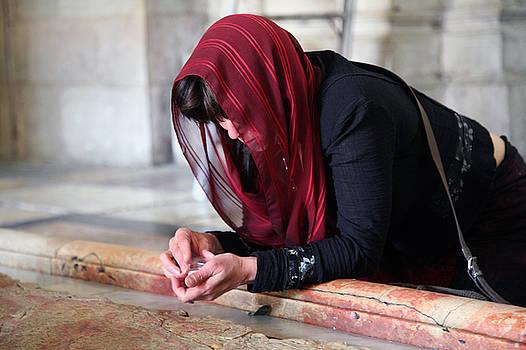 Christian Praying in Jerusalem by Jason Moore