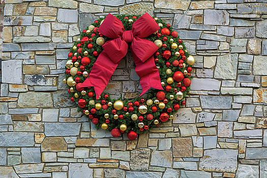 Christmas Holiday Wreath on Stone Wall by David Gn