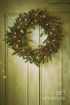 Sandra Cunningham - Christmas wreath with lights on vintage door