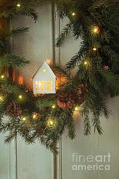 Sandra Cunningham - Christmas wreath with lights on vintage white door
