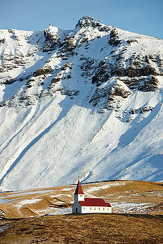 Church and mountains in winter Vik Iceland by Matthias Hauser