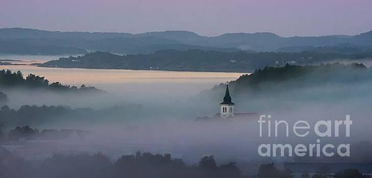 Church in fog by Mats Bjoerklund