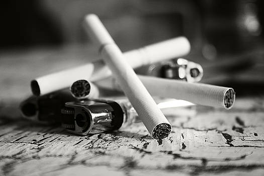 Cigarette and Lighters by Adam LeCroy