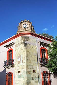 Clock on a Building by Jess Kraft