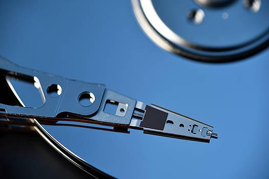 Reimar Gaertner - Close up of actuator arm on platter of hard disk drive data stor