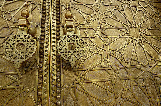 Reimar Gaertner - Close up of detailed engraving and knockers on the brass doors t