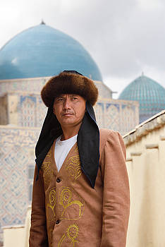 Reimar Gaertner - close up of man in traditional Kazakh clothes standing at Khoja