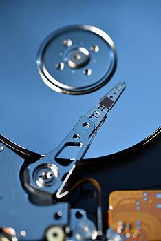 Reimar Gaertner - Close up of open hard disk drive data storage for laptop