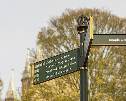 Jacek Wojnarowski - Close up of Tourist Information Directing Sign in Lincoln Cathedral Quarter