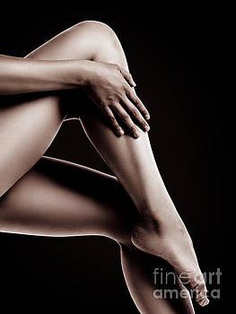 Closeup of Bare Woman Legs on Black Background by Oleksiy Maksymenko