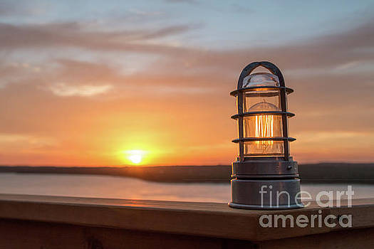 Closeup of light with sunset in the background by PorqueNo Studios