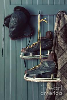 Sandra Cunningham - Closeup of old skates on hooks