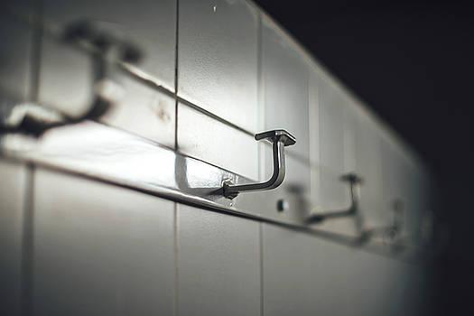 Eduardo Huelin - Clothes hooks in a sports center